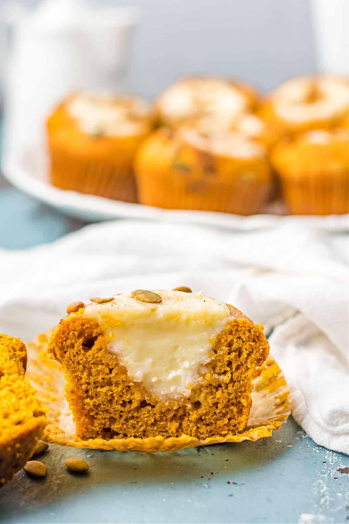 Pumpkin muffin with cream cheese filling cut in half.