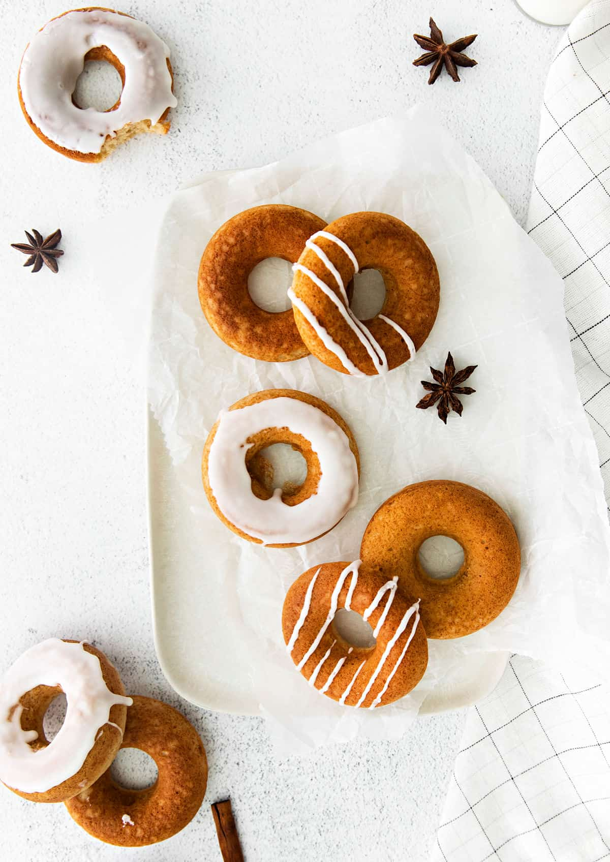 White serving plate with chai donuts.