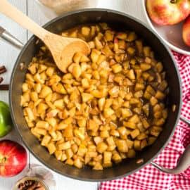 Cinnamon fried apples in large skillet.
