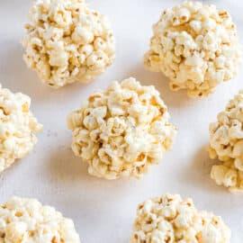 Popcorn balls on parchment paper.